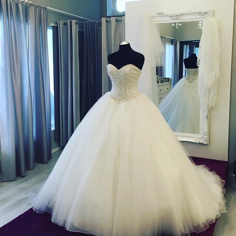 Strapless Sweetheart Beaded Tulle Ball Gown Wedding Gown Featuring Lace-Up Back and Long Train